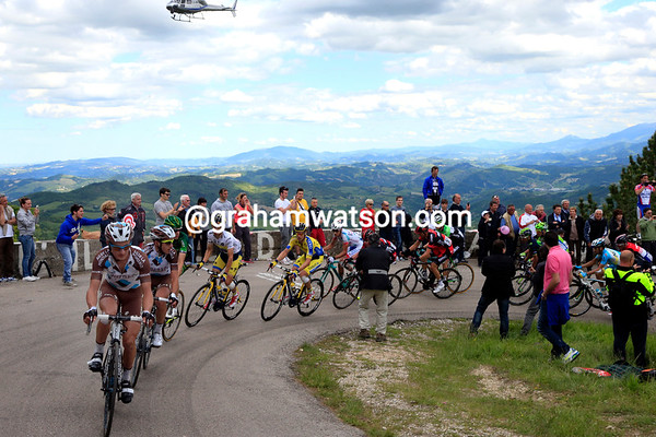 Ag2R leads a fragmented peloton up the sheer ascent...