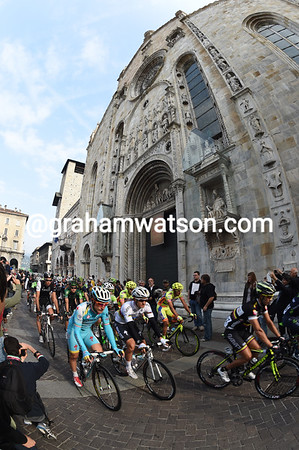 Kwiatkowski leads the peloton as it pedals past Como's giant Basilica...