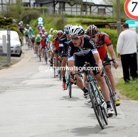 Tony Martin leads the peloton on to the Cote de Stockeu...