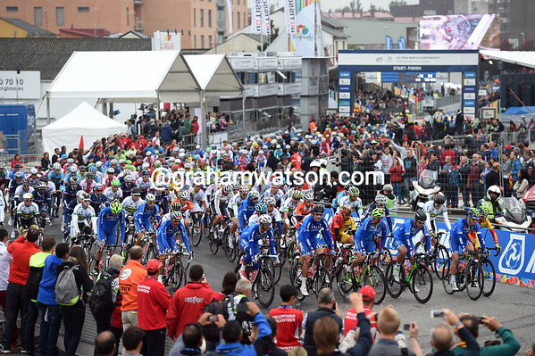 The Italian team leads the peloton as the race starts in Ponferrada...