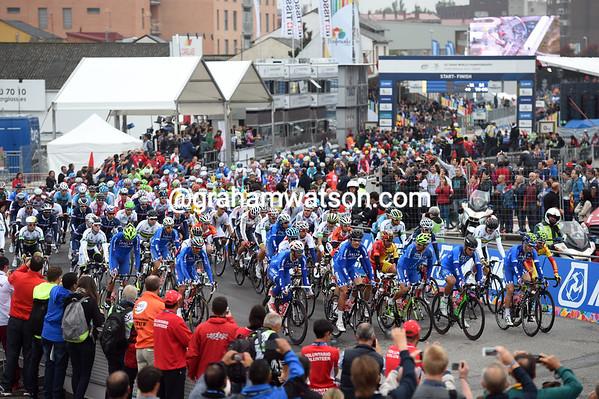 The Italian team leads the peloton as the race starts in Ponferrada...