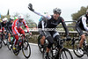 Who's he waving at? Cancellara is in fact waving his arms to get some warmth going...