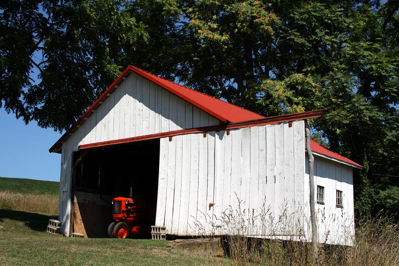 Vintage Allis Chalmers pokes it`s nose out of shed near Cross Mill.