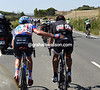 David Millar, a former rival and friend, pushes Cancellara along with his heavy burden of goods...