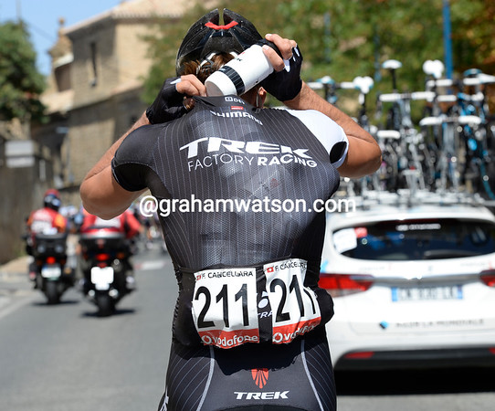 Fabian Cancellara has bent himself to the cause, he too loads up with water-bottles...