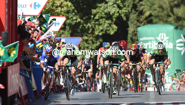 The sprint is between Degenkolb, Hofland, and a squeezed-in Bouhanni...