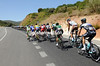 This is a day when little conversation takes place, except at the very back of the peloton...