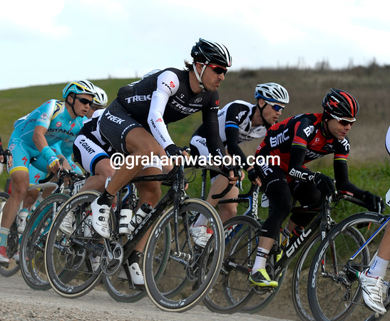 Evans has Fabian Cancellara next to him on a un-surfaced downhill section of the course...