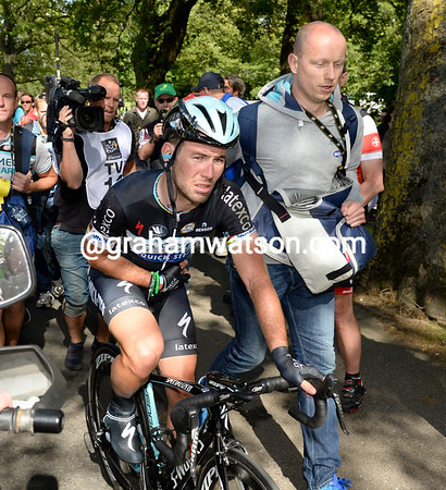 Mark Cavendish crashed in the last 500-metres and looks in distress as he crosses the line...