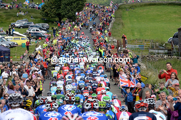 The peloton is cheered along by a very sporting crowd in Yorkshire...