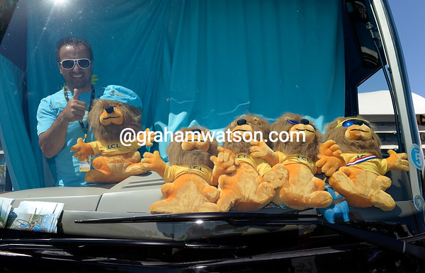 An Astana helper seems happy with his team's successes, so far...