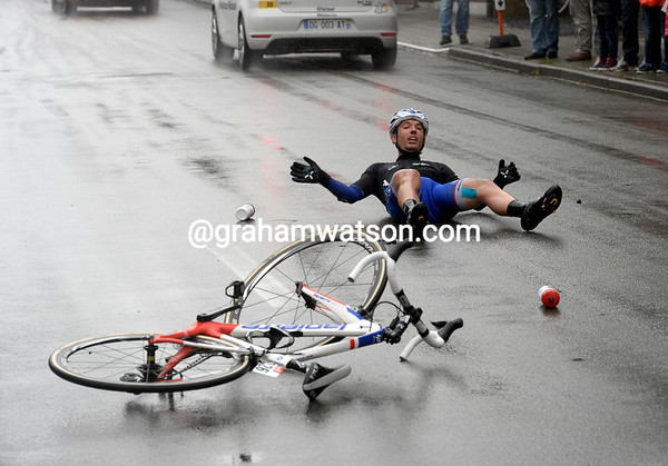 Cedric Pineau has slid over 20-metres after crashing in the wet conditions - Froome has fallen as well..!