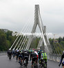 The peloton sets off across the brand-new Pont de la Poya in Fribourg...