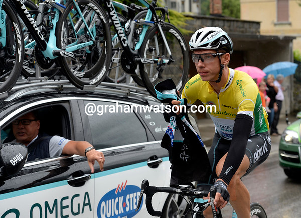 It must be very wet if Tony Martin is grabbing his rain-jacket...
