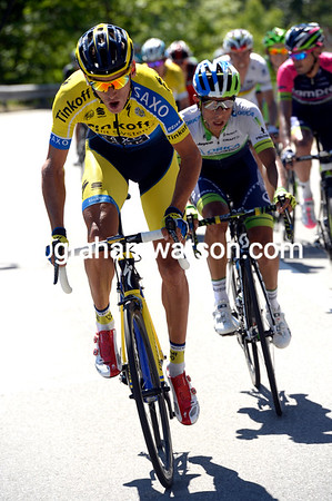 Roman Kreuziger attacks, only to see a Green Edge cyclist stuck to his wheel...