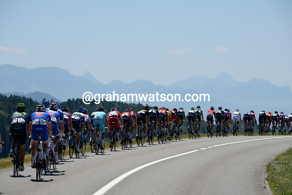 The peloton has mountains on its mind as it hurtles down towards Lac Leman...