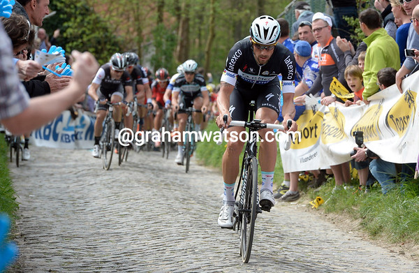 Tom Boonen lays down his intentions by flying up the Molenberg ahead of his rivals...