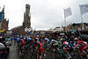 The peloton slips away from Bruges under wet skies and watched by massive crowds...