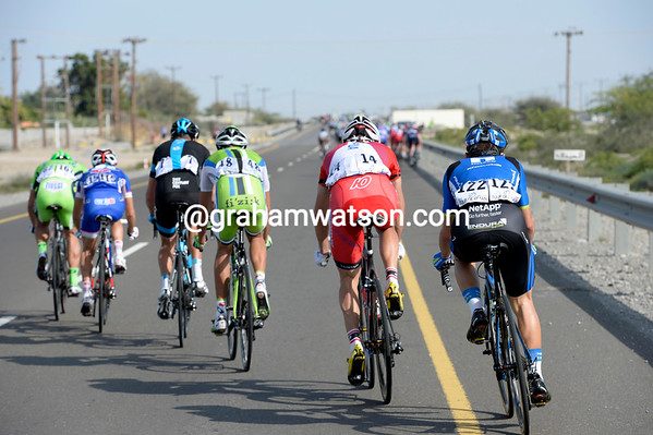 A sudden turn in direction has allowed the wind to split the peloton...