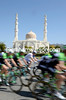 The peloton speeds past the Mosque over four minutes down...