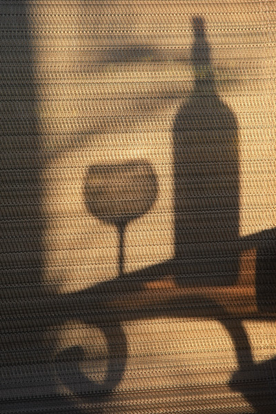 Shadow of wine bottle and glass