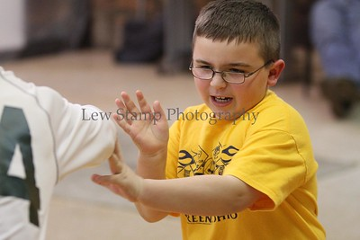 Cub Scout Jacob Sudbrink practices deflecting action in class on Friday Feb. 24  2012 in City of Green, Ohio. Cub Scout den leader Carrie Stephens decided her cubs  pack 3330, Den 11 needed help against bullies so she enlisted the help of  Northeast Martial arts, 4875 S. Main St. City of Green, Ohio   Image by Lew Stamp Photography.