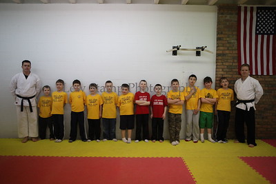 Cub Scouts listen to Craig Williams 4th Dan instructor  on Saturday Feb. 18  2012 in New Franklin, Ohio. Cub Scout den leader Carrie Stephens decided her cubs needed help against bullies so she enlisted the help of  Northeast Martial arts, 4875 S. Main St. City of Green, Ohio   Image by Lew Stamp Photography.