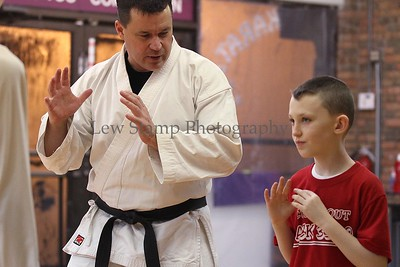 Cub Scout Blake Twiggs (right)  listens to Craig Williams 4th Dan instructor  on Saturday Feb. 18  2012 in City of Green, Ohio. Cub Scout den leader Carrie Stephens decided her cubs  pack 3330, Den 11 needed help against bullies so she enlisted the help of  Northeast Martial arts, 4875 S. Main St. City of Green, Ohio   Image by Lew Stamp Photography.