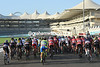 The peloton pedals towards empty tribunes on the Yas Marina Circuit...