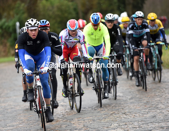 Jelle Wallays leads the way on to Cassel's cobblestones - Peter Sagan is in this lead group as well...