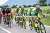 Matteo Tossato leads a Tinkoff pursuit with strong winds coming from the side...