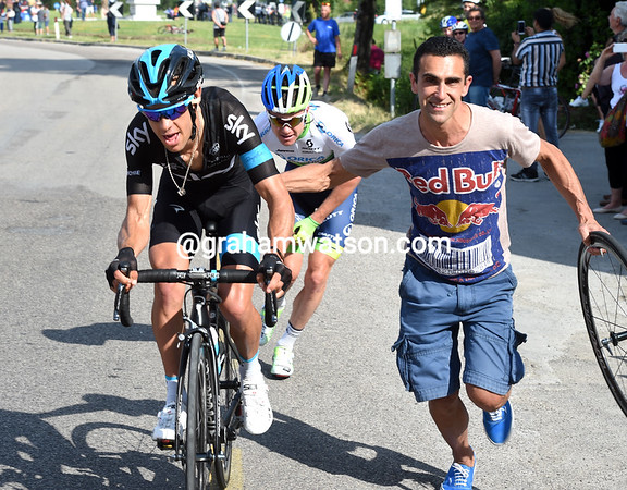 A keen fan jumps in to help Porte get on his way...