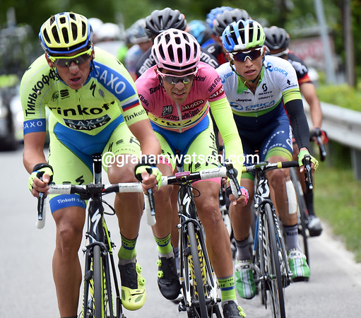 An embarassed Contador is being towed by a lone Tinkoff, Roman Kreuziger, almost one-minute back...