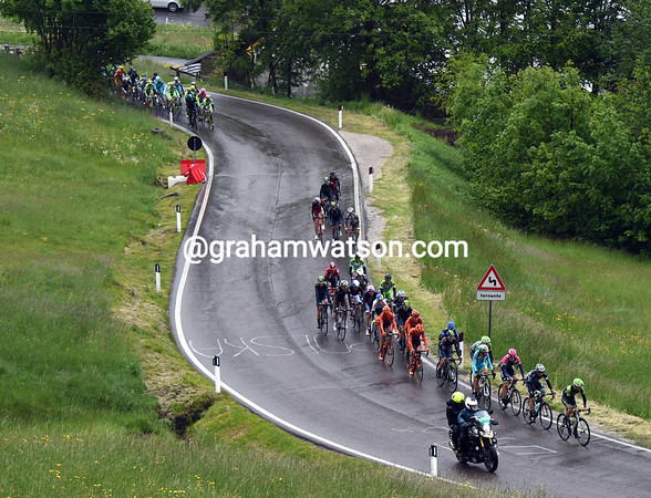 About 25 riders are getting away, but the peloton is just seconds behind...