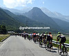 Hesjedal is last in the peloton as the Alps loom on the horizon..