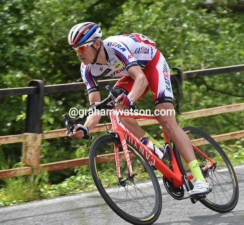 Pavel Kochtekov has attacked over the summit of the final climb and leads by 25-seconds on the long descent...