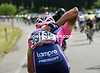 Another Chinese rider, Xu Gang, is collecting bottles for his Lampre teamates...