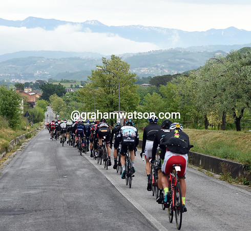 There are only about 95 riders left in the leading peloton after the first ascent...