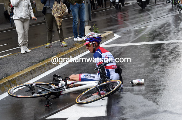 A sudden shower has claimed an Androni rider as a victim along with many others...