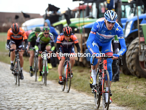 Frederik Backaert leads the remnants of the escape across the Kwaremont cobblestones...