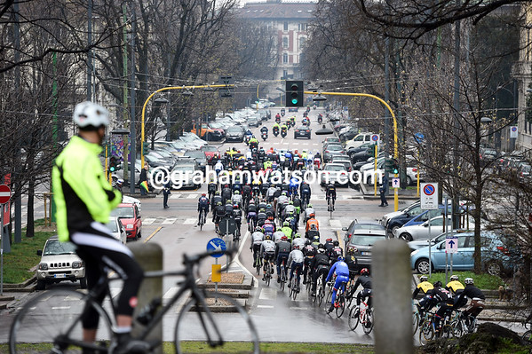 A cycling fan stops in Milan to watch Il Primavera leave the start...