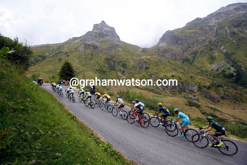 The Sky-led peloton climbs the Croix de Fer in pursuit of Rolland and Nibali...