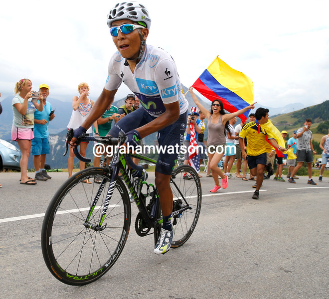 Fans of Quintana cheer their hero to the summit and finish line...