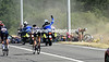 Gendarmes signal a massive crash as the racing starts in earnest - Cancellara (right) has fallen too..!