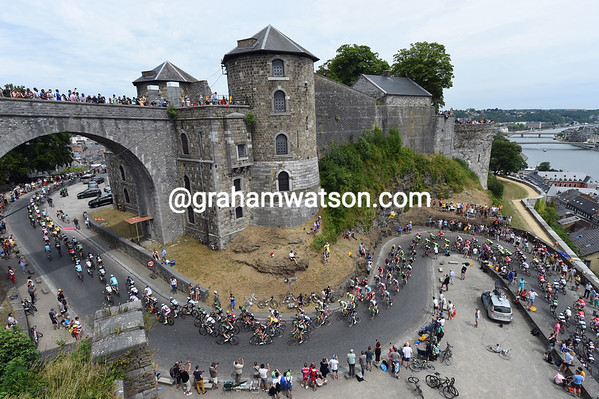 The peloton is in no mood to hurry as it climbs into the Citadel above Namur...