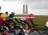 The peloton is passing the Canadian memorial in ones and twos after a huge crash earlier...