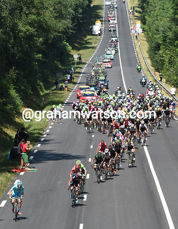 An Astana rider leads the day's first attack as the peloton bursts out of the start in Pau...