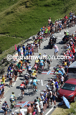 The fans cheer the Froome group as it approaches the summit of the Col du Tourmalet...