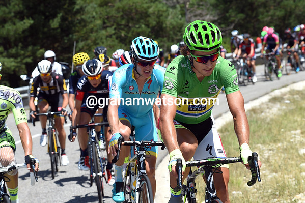 A sprinter, Peter Sagan, is leading a climber, Jacob Fuglsang, on a hill in an attempted escape...
