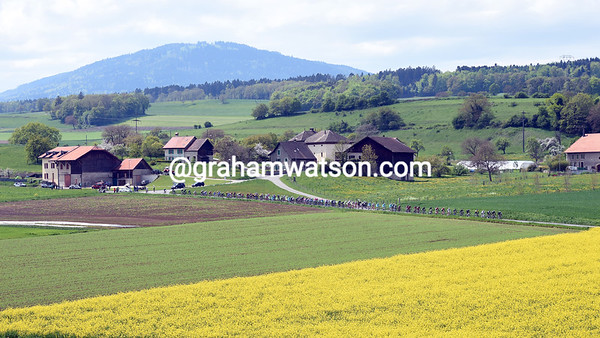 The peloton flies along the Val de Travers on its way to the main climbs of the day...